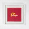 Framed hand embroidered McDonald's logo