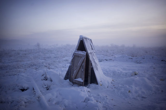 A toilet on the tundra at a petrol stop on the road to Oymyakon.  Journey to Oymyakon, considered by many to be the coldest permanently inhabited settlement in the world.