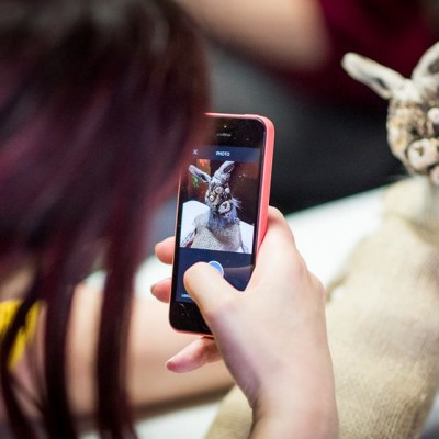 Layla Holzer photographing her puppet